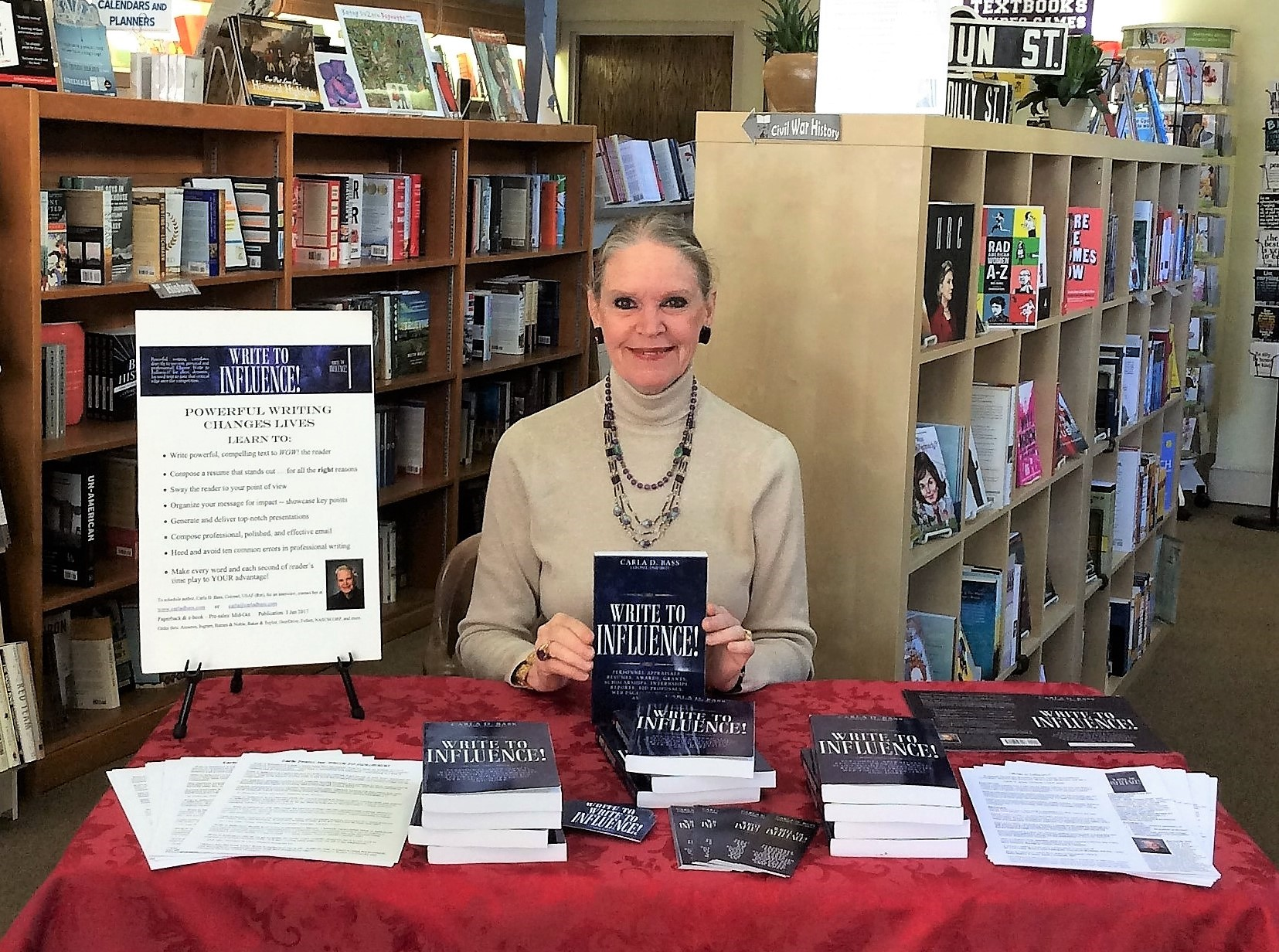 Carla D. Bass, author of award-winning book Write to Influence! signs books at a book store